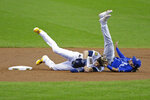 Milwaukee Brewers' Christian Yelich collides with Kansas City Royals' Nicky Lopez after being tagged out at second base during the first inning of a baseball game Sunday, Sept. 20, 2020, in Milwaukee. (AP Photo/Aaron Gash)