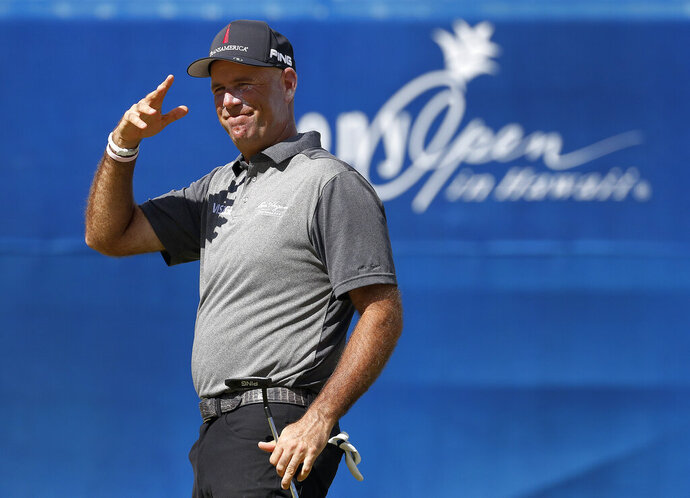 Stewart Cink reacts after saving par on the 18th green during the second round of the Sony Open PGA Tour golf event, Friday, Jan. 11, 2019, at Waialae Country Club in Honolulu. (AP Photo/Matt York)