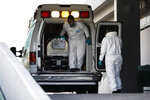 A patient is a capsule is moved from an ambulance into the COVID-19 treatment center at Dr. Carlos MacGregor Sanchez General Hospital in Mexico City, Sunday, Jan. 10, 2021.In Mexico City, the current epicenter of the pandemic in Mexico, 90% percent of hospital beds are full, and the country continues to break daily records of newly confirmed coronavirus cases.(AP Photo/Rebecca Blackwell)