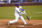 Los Angeles Dodgers' Justin Turner connects for a three-run home run during the eighth inning of the team's baseball game against the San Diego Padres on Wednesday, Aug. 12, 2020, in Los Angeles. (AP Photo/Marcio Jose Sanchez)