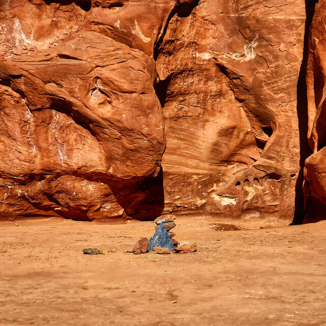 In this Saturday, Nov. 28, 2020, photo provided by Kelsea Dockham, rocks mark the location where a metal monolith once stood in the ground in a remote area of red rock in Spanish Valley, Utah south of Moab near Canyonlands National Park. The mysterious silver monolith that was placed there has disappeared less than 10 days after it was spotted by wildlife biologists performing a helicopter survey of bighorn sheep, federal officials and witnesses said. (Kelsea Dockham/Canyon State Overland via AP)