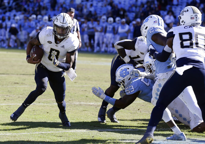 Georgia Tech Tobias Oliver (8) runs for a touchdown during the second half of an NCAA college football game against North Carolina in Chapel Hill, N.C., Saturday, Nov. 3, 2018. Georgia Tech won 38-28. (AP Photo/Gerry Broome)