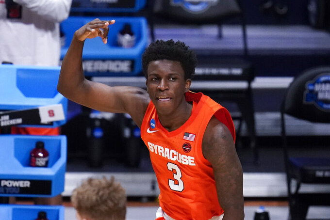 Syracuse forward Kadary Richmond (3) reacts to a three-point basket against Houston in the second half of a Sweet 16 game in the NCAA men's college basketball tournament at Hinkle Fieldhouse in Indianapolis, Saturday, March 27, 2021. (AP Photo/Michael Conroy)