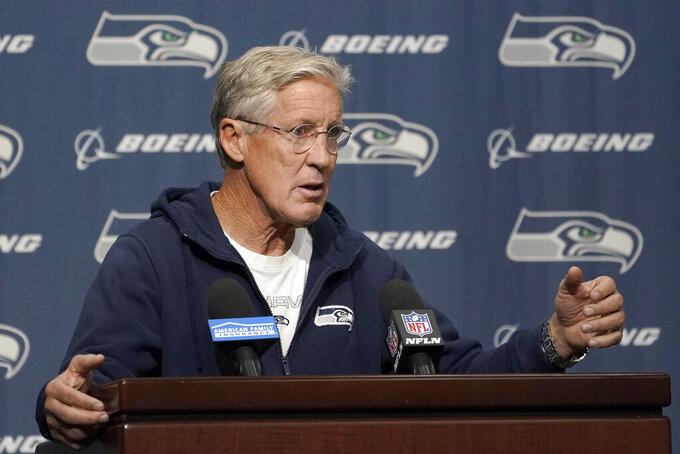Seattle Seahawks head coach Pete Carroll talks to reporters before NFL football practice, Wednesday, Oct. 13, 2021, in Renton, Wash. (AP Photo/Ted S. Warren)