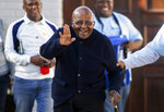 """FILE- In this Monday May 6, 2019. file photo Anglican Archbishop Emeritus Desmond TutU exits his home in Cape Town, South Africa. Ugandan activist Vanessa Nakate has challenged world leaders to """"wake up"""" and recognize climate change as a crisis. In a speech broadcast as part of the Desmond Tutu International Peace Lecture, she tied the issue to poverty, hunger, disease, conflict and even violence against women and girls.  (AP Photo, File)"""