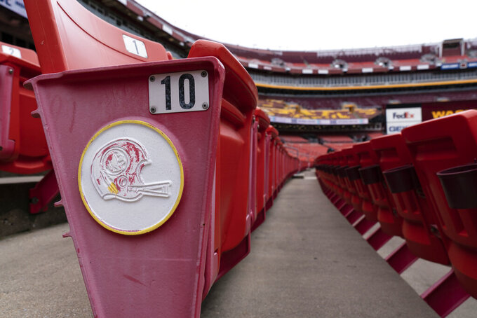 The former logo for the Washington football team is seen on the sides of the seats before an NFL football practice at FedEx Field, Monday, Aug. 31, 2020, in Washington. (AP Photo/Alex Brandon)