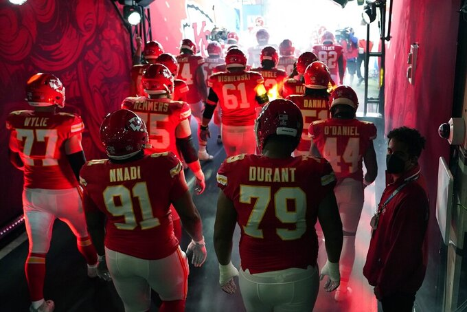The Kansas City Chiefs run onto the field before the NFL Super Bowl 55 football game between the Kansas City Chiefs and Tampa Bay Buccaneers, Sunday, Feb. 7, 2021, in Tampa, Fla. (AP Photo/David J. Phillip)