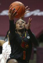 Louisville's Dana Evans scores against Virginia Tech in the second half of an NCAA college basketball game Thursday, Jan. 7, 2021, in Blacksburg, Va. (Matt Gentry/The Roanoke Times via AP, Pool)
