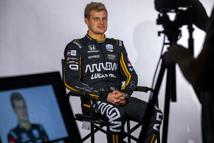 IndyCar driver Marcus Ericsson, of Sweden, is interviewed during IndyCar auto racing media day, Monday, Feb. 11, 2019, in Austin, Texas. (AP Photo/Stephen Spillman)