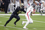 File-This Nov. 22, 2020, file photo shows New Orleans Saints defensive end Trey Hendrickson (91) sacking Atlanta Falcons quarterback Matt Ryan (2) in the first half of an NFL football game in New Orleans. After free agent Carl Lawson signed with the Jets, the Bengals hoped to bolster their pass rush by picking up Hendrickson, an edge rusher who logged 13.5 sacks with the Saints last year.  (AP Photo/Brett Duke, File)