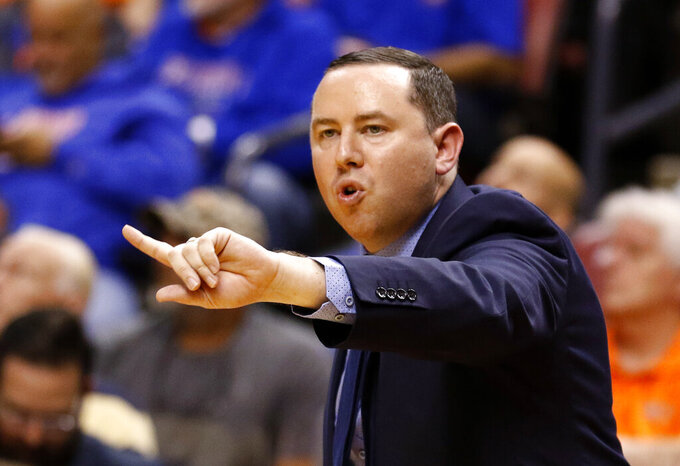 """FILE - In this Dec. 22, 2018, file photo, Florida Gulf Coast coach Michael Fly gestures during the team's NCAA college basketball game against Florida at the Orange Bowl Classic in Sunrise, Fla. Fly, now the head coach at Florida Gulf Coast, was an assistant on the 2013 """"Dunk City"""" team that became the first No. 15 seed to make it out of the tournament's first weekend. (AP Photo/Joe Skipper, File)"""