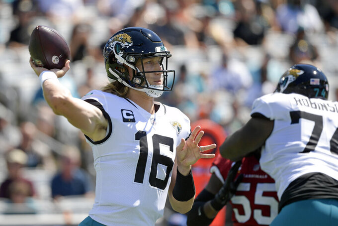 Jacksonville Jaguars quarterback Trevor Lawrence (16) throws a pass against the Arizona Cardinals during the first half of an NFL football game, Sunday, Sept. 26, 2021, in Jacksonville, Fla. (AP Photo/Phelan M. Ebenhack)