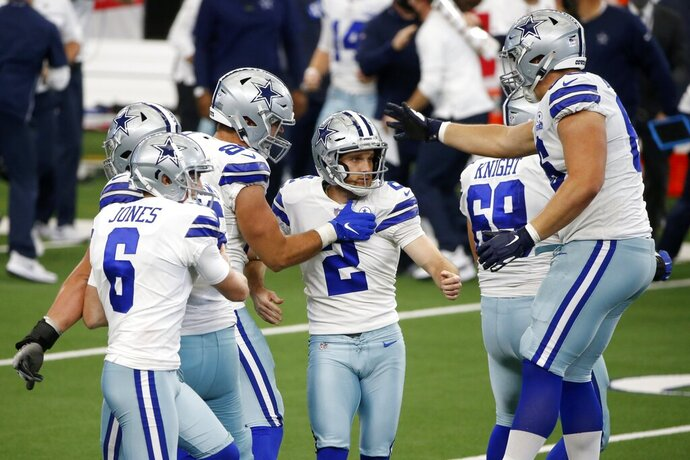 Dallas Cowboys' Chris Jones (6) and others celebrate with kicker Greg Zuerlein (2) after Zuerlein kicked a field goal to help the Cowboys to a 40-39 win against the Atlanta Falcons in an NFL football game in Arlington, Texas, Sunday, Sept. 20, 2020. (AP Photo/Michael Ainsworth)