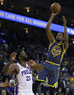 Golden State Warriors' Kevin Durant shoots over Philadelphia 76ers' Joel Embiid (21) during the second half of an NBA basketball game Thursday, Jan. 31, 2019, in Oakland, Calif. (AP Photo/Ben Margot)