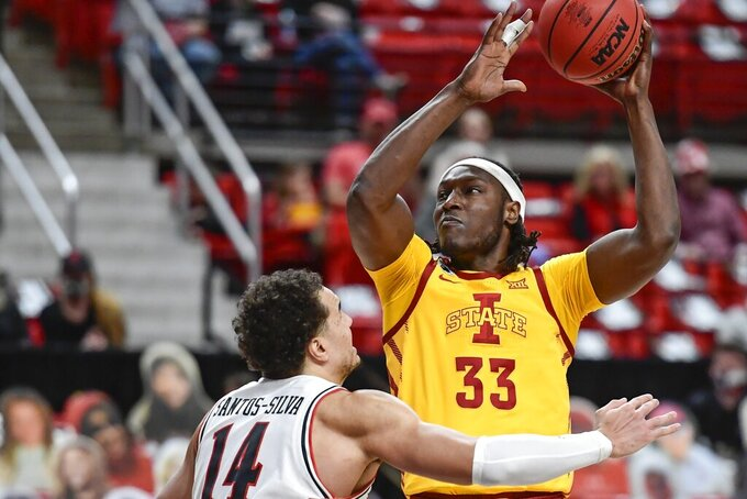 Iowa State's Solomon Young (33) attempts to shoot over Texas Tech's Marcus Santos-Silva (14) during the first half of an NCAA college basketball game in Lubbock, Texas, Thursday, March 4, 2021. (AP Photo/Justin Rex)