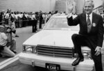 CORRECT CREATION DATE TO AUG. 6, NOT 7 - FILE - In this Aug. 6, 1980, file photo, Chrysler Corp. Chairman Lee Iacocca sits on the hood of K Car Number One, a Plymouth Reliant, in Detroit. Former Chrysler CEO Iacocca, who became a folk hero for rescuing the company in the '80s, has died, former colleagues said Tuesday, July 2, 2019. He was 94. (AP Photo/Dale Atkins, File)