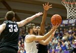 Gonzaga forward Killian Tillie, center, shoots past Portland center Theo Akwuba, right, and forward Jacob Tryon, left, during the first half of an NCAA college basketball game in Portland, Ore., Saturday, Jan. 19, 2019. (AP Photo/Craig Mitchelldyer)