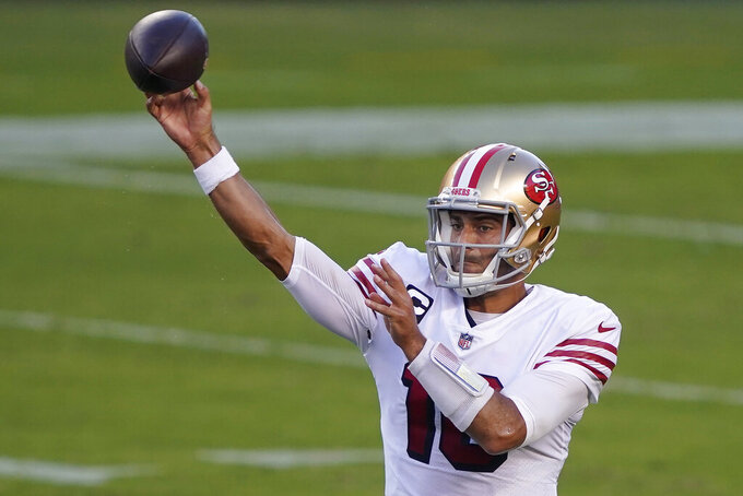 San Francisco 49ers quarterback Jimmy Garoppolo passes against the Los Angeles Rams during the first half of an NFL football game in Santa Clara, Calif., Sunday, Oct. 18, 2020. (AP Photo/Tony Avelar)