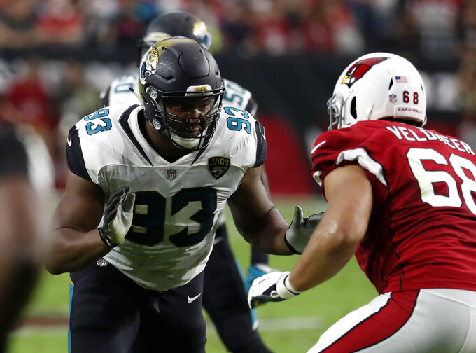 File-This Nov. 26, 2017, file photo shows Jacksonville Jaguars defensive end Calais Campbell (93) against the Arizona Cardinals during the first half of an NFL football game, in Glendale, Ariz. On Monday, Feb. 18, 2019, the Jaguars formally exercised a $12 million option on Pro Bowl defensive end  Campbell for 2019. (AP Photo/Rick Scuteri, File)