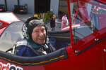 Kenneth Schrammeck, 98, beams from the front seat of a Boeing-Stearman Model 75 biplane at Glacier International Airport on Thursday, Aug. 26, 2021. (Jeremy Weber/Daily Inter Lake via AP)