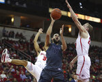 Nevada's Caleb Martin (10) tries to shoot over Fresno State's Sam Bittner, right, during the first half of an NCAA college basketball game in Fresno, Calif., Saturday, Jan. 12, 2019. (AP Photo/Gary Kazanjian)