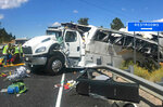 FILE - This photo released by the Garfield County Sheriff's Office shows a tour bus that crashed near Bryce Canyon National Park in southern Utah on Friday, Sept. 20, 2019. Federal investigators say a tour bus crash that threw more than a dozen people onto a remote Utah highway in 2019 and killed four Chinese tourists highlights a lack of safety standards for bus roofs and windows. The National Transportation Safety Board released its final report on the crash Thursday, June 3, 2021.(Sheriff Danny Perkins/Garfield County Sheriff's Office via AP, File)