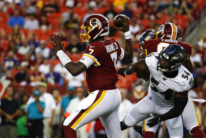 Washington Redskins quarterback Dwayne Haskins (7) throws the ball under pressure from Baltimore Ravens linebacker Tyus Bowser (54) during the first half of an NFL preseason football game Thursday, Aug. 29, 2019, in Landover, Md. (AP Photo/Alex Brandon)