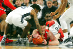 Penn State's Jamari Wheeler (5) and Ohio State's Kyle Young (25) battle for a loose ball during first half action of an NCAA college basketball game, Saturday, Jan. 18, 2020, in State College, Pa. (AP Photo/Gary M. Baranec)