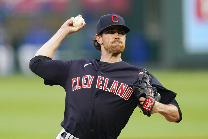 Cleveland Indians starting pitcher Shane Bieber throws during the first inning of a baseball game against the Kansas City Royals Wednesday, May 5, 2021, in Kansas City, Mo. (AP Photo/Charlie Riedel)
