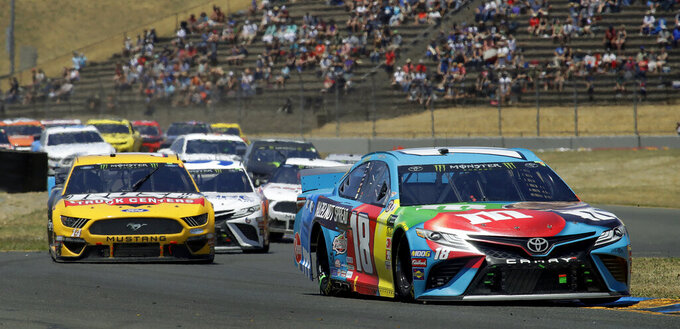 Kyle Busch (18) leads through a turn during a NASCAR Sprint Cup Series auto race Sunday, June 23, 2019, in Sonoma, Calif. (AP Photo/Ben Margot)