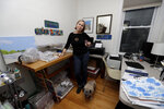 In this Jan. 8, 2020, photo Marian Nixon poses for a photo at her home in Chicago. Nixon finds its easier for her prints, clothes and sketch books to be seen on Amazon rather than on her own website. But selling online presents challenges that can be hard, even impossible to overcome. She gets good reviews for her designs, but she's had bad reviews when something has gone wrong with shipping, which is out of her control. (AP Photo/Nam Y. Huh)
