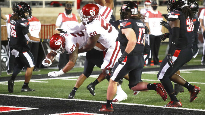 Oklahoma's Jeremiah Hall scores a touchdown against Texas Tech during the first half of an NCAA college football game Saturday, Oct. 31, 2020, in Lubbock, Texas. (AP Photo/Mark Rogers)