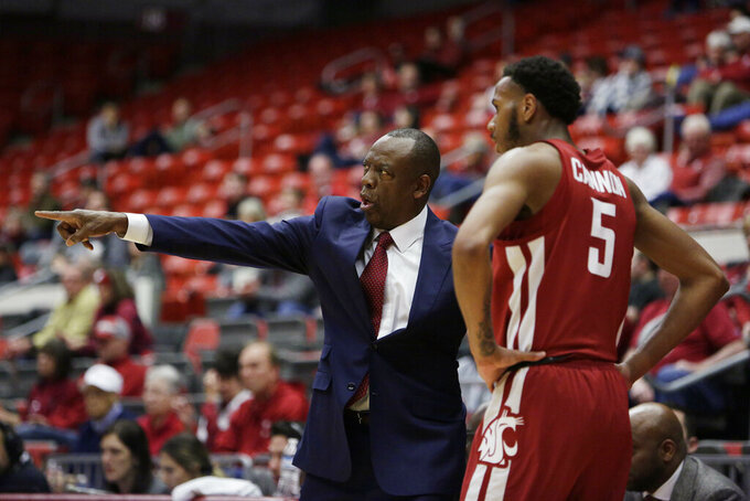Washington State coach Ernie Kent, left, speaks with forward Marvin Cannon during the second half of an NCAA college basketball game against Colorado in Pullman, Wash., Wednesday, Feb. 20, 2019. Washington State won 76-74. (AP Photo/Young Kwak)