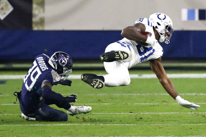 Indianapolis Colts tight end Mo Alie-Cox (81) is tripped up by Tennessee Titans cornerback Breon Borders (39) in the second half of an NFL football game Thursday, Nov. 12, 2020, in Nashville, Tenn. (AP Photo/Wade Payne)