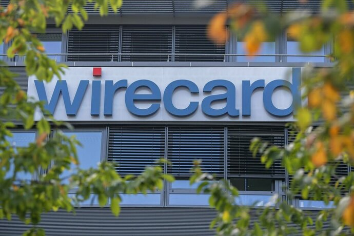 FILE -- In this Tuesday, Sept. 18, 2018 photo the 'wirecard' company headquarters is pictured in Ascheim, Germany.  Germany's financial market regulator has issued a two-month ban on short-selling shares in Wirecard AG, whose stock has swung sharply in recent months.  (Peter Kneffel/dpa via AP)