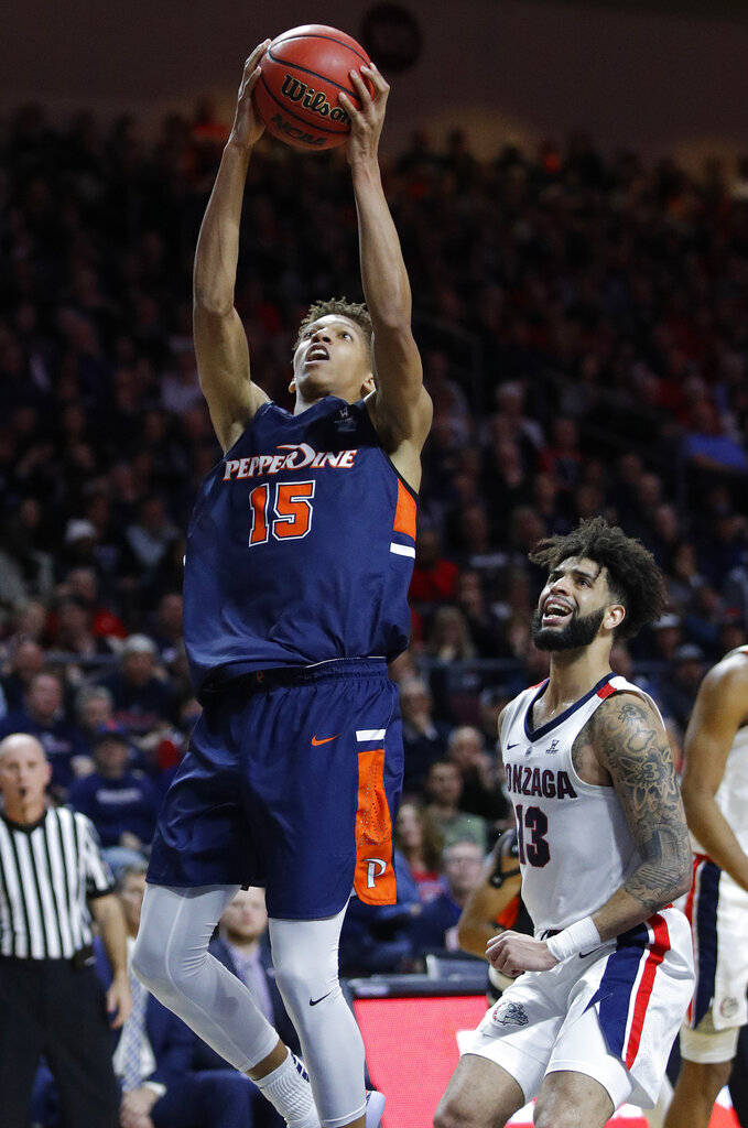 Pepperdine's Kessler Edwards (15) shoots over Gonzaga's Josh Perkins during the second half of an NCAA semifinal college basketball game at the West Coast Conference tournament, Monday, March 11, 2019, in Las Vegas. (AP Photo/John Locher)