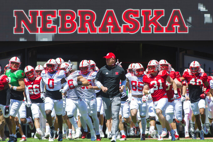 Nebraska head coach Scott Frost and the Huskers run on to the field to a sea of fans for the first time since the pandemic started before the Red-White Spring game at Memorial Stadium in Lincoln, Neb. on Saturday, May 1, 2021. (Kenneth Ferriera/Lincoln Journal Star via AP)