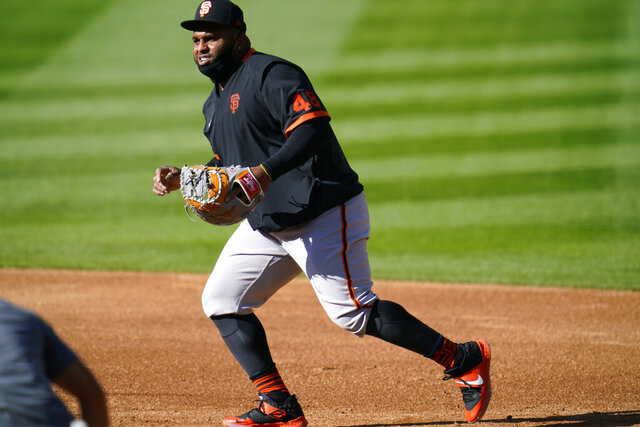 San Francisco Giants third baseman Pablo Sandoval warms up before the team's baseball game against the Colorado Rockies on Tuesday, Sept. 1, 2020, in Denver. (AP Photo/David Zalubowski)