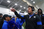 Kentucky quarterback Lynn Bowden Jr. (1) greets fans before the NCAA college football game against Louisville, Saturday, Nov. 30, 2019, in Lexington, Ky. (AP Photo/Bryan Woolston)