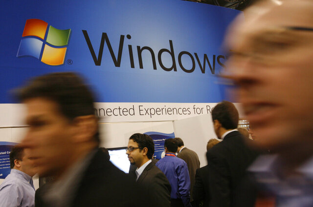 FILE - In this Jan. 11, 2010 file photo, a display for Microsoft's Windows 7 is shown at the National Retail Federation's convention in New York. Users still running Microsoft's Windows 7, on their computer's might be at risk. Microsoft is no longer providing free security updates for the system as of Tuesday, Jan. 14, 2020, meaning computers using it will be more vulnerable to viruses and malware.  Users who want to protect their data need to upgrade to Windows 10. (AP Photo/Mark Lennihan, File)
