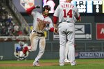 Washington Nationals' Juan Soto, left, rounds third base on a two-run home run off Minnesota Twins pitcher Kohl Stewart during the sixth inning of a baseball game Thursday, Sept. 12, 2019, in Minneapolis. (AP Photo/Jim Mone)