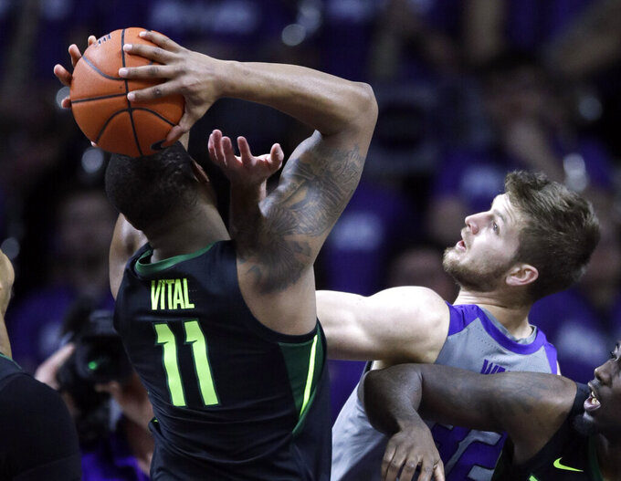Kansas State forward Dean Wade, right, reaches inagainst Baylor guard Mark Vital (11) during the first half of an NCAA college basketball game in Manhattan, Kan., Saturday, March 2, 2019. (AP Photo/Orlin Wagner)