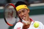 FILE - In this May 30, 2018, file photo, Japan's Kei Nishikori returns a shot against France's Benoit Paire during their second round match of the French Open tennis tournament at the Roland Garros stadium in Paris, France. (AP Photo/Christophe Ena, File)