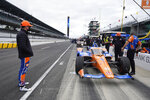 Scott Dixon, of New Zealand, stands on pit road during the final practice session for the Indianapolis 500 auto race at Indianapolis Motor Speedway, Friday, May 28, 2021, in Indianapolis. (AP Photo/Darron Cummings)