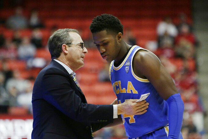 UCLA interim coach Murry Bartow, left, speaks with guard David Singleton during the second half of the team's NCAA college basketball game against Washington State in Pullman, Wash., Wednesday, Jan. 30, 2019. UCLA won 87-67. (AP Photo/Young Kwak)