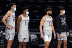 Northwestern players watch during the second half of the team's NCAA college basketball game against Pittsburgh in Evanston, Ill., Wednesday, Dec. 9, 2020. Pittsburgh won 71-70. (AP Photo/Nam Y. Huh)