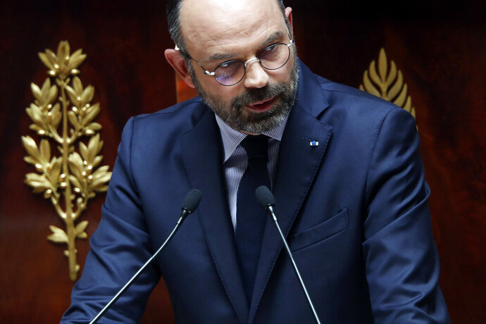 France's Prime Minister Edouard Philippe delivers a speech at the National Assembly, in Paris, Wednesday, June 12, 2019. France's prime minister vowed to keep reforming the country's economy through changes to the unemployment benefits, the pension system and tax cuts for middle-class workers. Edouard Philippe laid down Wednesday the government's upcoming priorities at the lower house of parliament, the National Assembly. (AP Photo/Thibault Camus)
