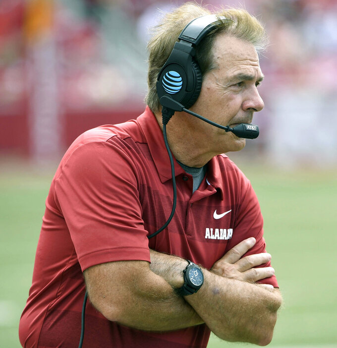 FILE - In this Oct. 6, 2018, file photo, Alabama coach Nick Saban watches his team play Arkansas in the second half of an NCAA college football game, in Fayetteville, Ark. The Tigers are set to square off against the Crimson Tide for the fourth straight year in the College Football Playoff in Monday night's, Jan. 7, 2019,  title game. While most of the players have changed since Alabama won the first meeting for the championship in January 2016, the coaches have remained the same. (AP Photo/Michael Woods, File)