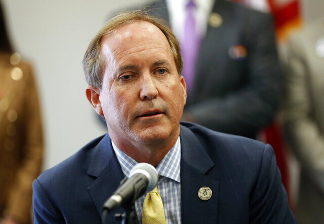 "FILE- In this Sept. 10, 2020, file photo, Texas Attorney General Ken Paxton speaks at the Austin Police Association in Austin, Texas. Paxton on Wednesday, Dec. 16, 2020, announced a multi-state lawsuit against Google, accusing the search giant of ""anti-competitive conduct"