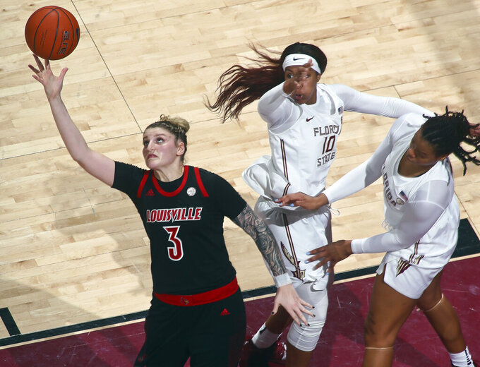 Louisville forward Sam Fuehring (3) reaches for a loose ball as Florida State guard Kourtney Weber (10) and forward Valencia Myers (32) defend during the first half of an NCAA college basketball game in Tallahassee, Fla., Thursday, Jan. 24, 2019. (AP Photo/Phil Sears)